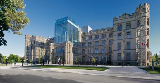 Photo of the Canadian Museum of Nature in Ottawa, ON. The 4 storey heritage 'Castle-style' building has a new glass tower at the front as the new accessible entry.